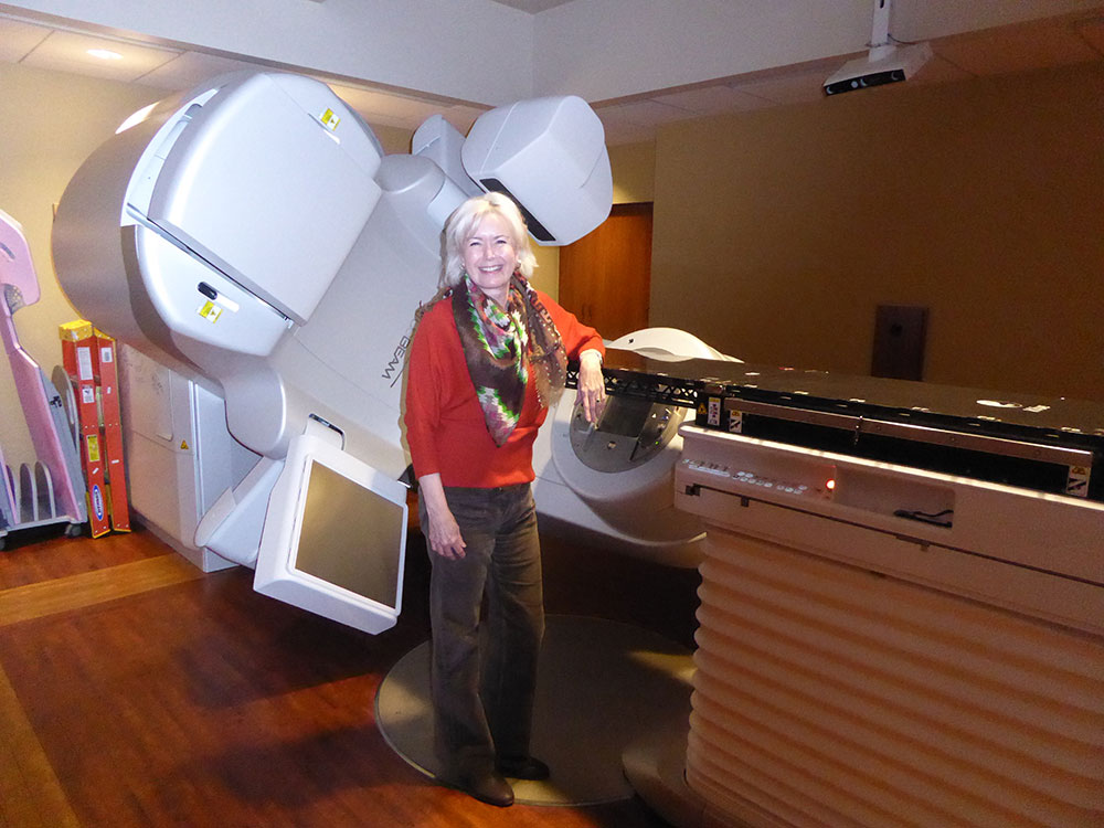 Daphne Palmer standing in front of CT scanner