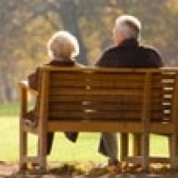 Older couple sitting on a bench